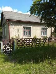 продается полностью изолированная половина кирпичного дома